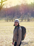 The girl with the backpack in the Park. Stock Photos