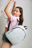 Girl with a backpack Royalty Free Stock Images