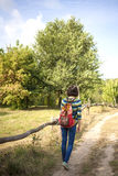 The girl with the backpack traveling alone. Royalty Free Stock Photo