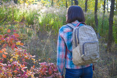 The girl with the backpack. Stock Photos