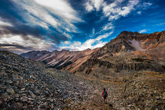 Girl Backpacker on a Crystal Lake Trail above the Ophir Pass Sum Royalty Free Stock Images