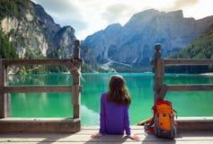 Girl backpacker looking at Braies lake stock photos