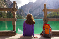 Girl backpacker looking at Braies lake Royalty Free Stock Photos