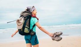 Girl backpacker traveler enjoys with fresh ocean wind Royalty Free Stock Image
