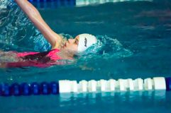 Girl backstroke Royalty Free Stock Photography