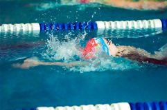 Girl backstroke Stock Images