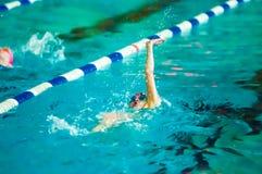 Girl backstroke Stock Images