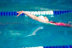 Girl backstroke Royalty Free Stock Photo