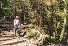 Girl at Baden Powell Trail near Quarry Rock at North Vancouver,. Photo of Girl at Baden Powell Trail near Quarry Rock at North Vancouver, BC, Canada Stock Photo