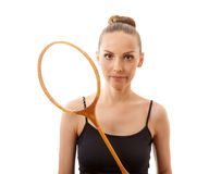 Girl with a badminton racket Royalty Free Stock Photography