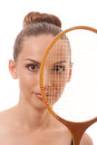 Girl with a badminton racket Royalty Free Stock Images