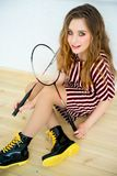 Girl with a badminton racket. A portrait of a girl with a badminton racket Stock Images