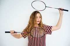 Girl with a badminton racket. A portrait of a girl with a badminton racket Stock Photos