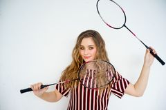 Girl with a badminton racket. A portrait of a girl with a badminton racket Stock Photo