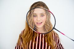 Girl with a badminton racket. A portrait of a girl with a badminton racket Stock Photography