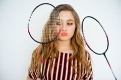 Girl with a badminton racket. A portrait of a girl with a badminton racket Royalty Free Stock Image