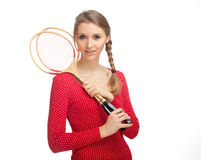 Girl with badminton rackets Stock Image