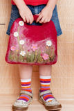 Girl with handmade felted bag Royalty Free Stock Photography
