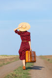 Girl with bag. Beautiful girl in plaid dress with bag on countryside Royalty Free Stock Photos