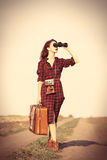 Girl with bag and binocular Royalty Free Stock Photography