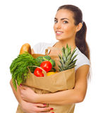 Girl with a bag full of products Stock Images