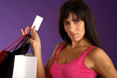 Girl with bag hold white card in hand Royalty Free Stock Photo