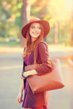 Girl with bag. Redhead girl in hat and bag in the autumn park Stock Photo