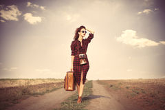 Girl with bag and retro camera Royalty Free Stock Photo
