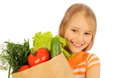 Girl with bag of vegetabl Stock Photography