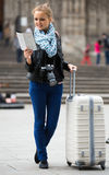 Girl with baggage and city map Royalty Free Stock Photos