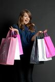 Girl with bags. Happy girl with a package worth Royalty Free Stock Photo