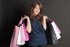Girl with bags. Happy girl with a package worth Stock Photos