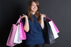 Girl with bags. Happy girl with a package worth Stock Images