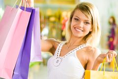 Girl with bags Stock Photography