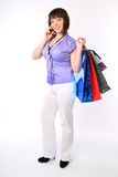 Girl with bags and cell phone Stock Photography