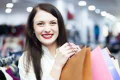 Girl with bags at clothing boutique Royalty Free Stock Photography