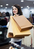 Girl with bags at fashion boutique Stock Image