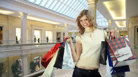 Girl with bags in shop collage Royalty Free Stock Photography