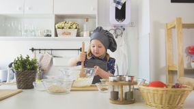 Girl baker mixes the mixture for cookies with a whisk. Close up Royalty Free Stock Photography