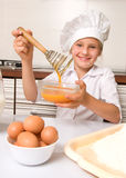 Girl baking Stock Images