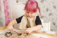 Girl baking Christmas cookies Royalty Free Stock Photo
