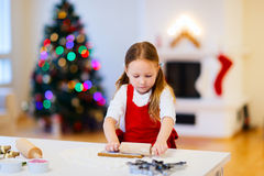 Girl baking Christmas cookies Royalty Free Stock Image