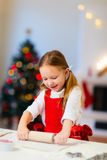 Girl baking Christmas cookies Stock Photos