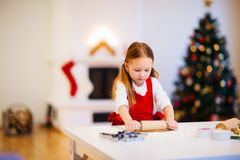 Girl baking Christmas cookies Stock Photography