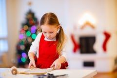 Girl baking Christmas cookies Royalty Free Stock Photography