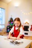 Girl baking Christmas cookies Stock Photography