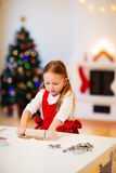 Girl baking Christmas cookies Stock Photos