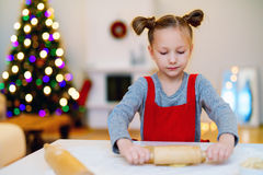 Girl baking Christmas cookies Royalty Free Stock Photography