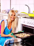 Girl baking cookies in the oven Royalty Free Stock Photos