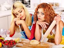 Girl baking cookies in the oven Stock Image